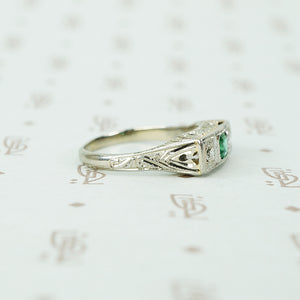 belias white gold filigree 3 stone ring emerald and diamond side view