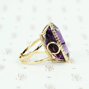 extra big oval amethyst ring in cut back collet side detail of open setting