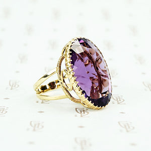 extra big oval amethyst ring in cut back collet