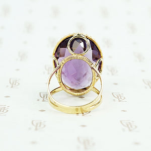 extra big oval amethyst ring in cut back collet side detail of back