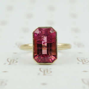 4.47 carat emerald cut pink tourmaline in matte gold ring