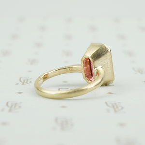 4.47 carat emerald cut pink tourmaline in matte gold ring back