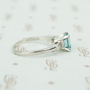 emerald cut aquamarine with baguette diamond sides in platinum side view