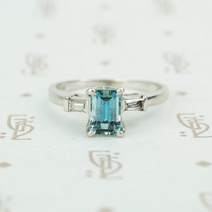emerald cut aquamarine with baguette diamond sides in platinum