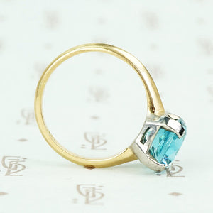 Natural blue zircon solitaire in palladium and 14k yellow gold