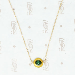 artisan necklace emeralds and recycled gold close up
