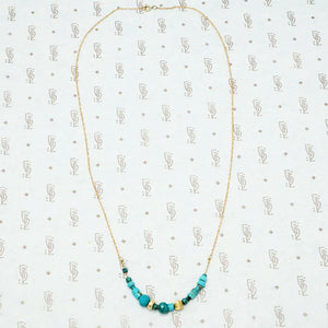 artisan crafted turquoise and gold necklace