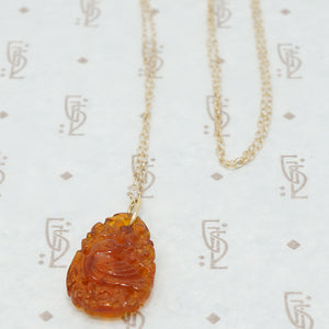 carved amber pendant with birds