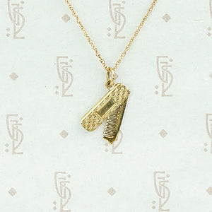 Swiveling Comb Gold Charm Necklace