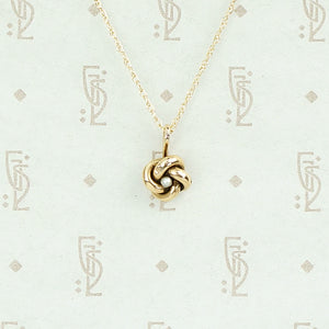Tiny Love Knot Pendant With Pearl