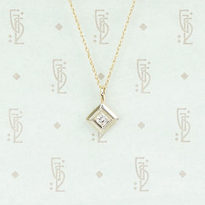1920s Two Tone Gold and Diamond Pendant