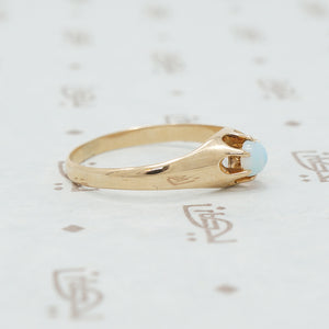 rose gold claw set opal ring side view