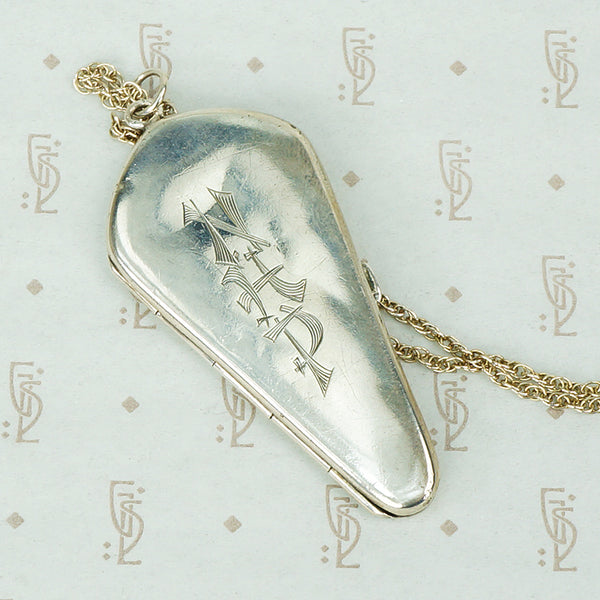 unusual coffin shaped silver antique locket