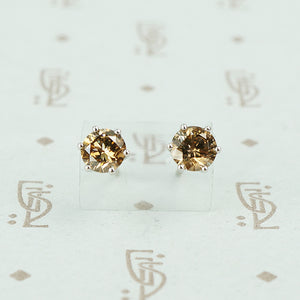 1 carat total weight cognac diamond studs in 18k white gold