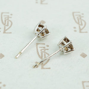 1 carat total weight cognac diamond studs in 18k white gold side view