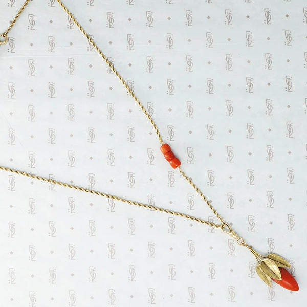 coral and gold acorn on a gold chain