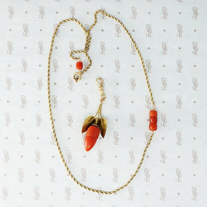 gold and coral acorn on gold rope chain