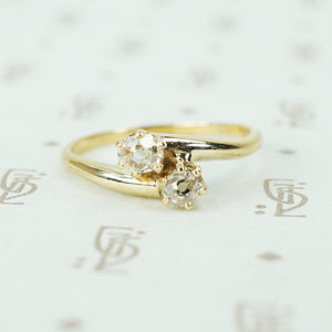 old mine cut diamond cross over yellow gold engagement ring