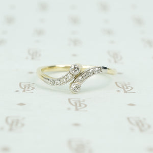 vintage diamond platinum and gold crossover ring