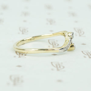 vintage diamond platinum and gold crossover ring side view