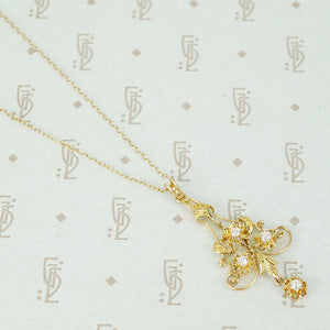 edwardian gold and diamond pendant close up