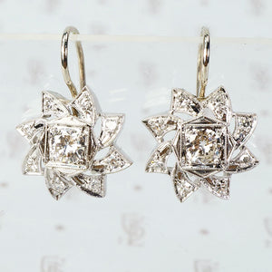 vintage 1940's 4k white gold and diamond pinwheel shaped earrings