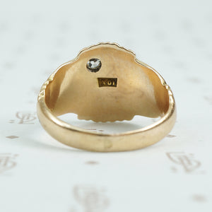 Gold signet ring with engraved j topped with a mine cut diamond back view
