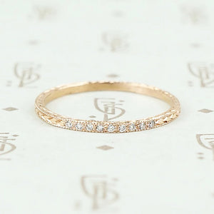 The diamond wheat band by 720 in rose gold.