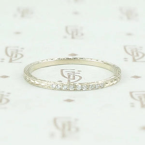 The diamond wheat band by 720 in white gold.