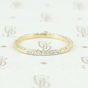 The diamond wheat band by 720 in yellow gold.