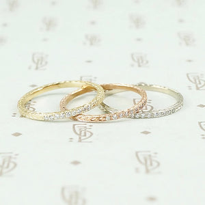 The diamond wheat band by 720 in yellow, white and rose gold.