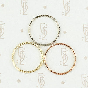The diamond wheat band by 720 in yellow, white and rose gold in top view.