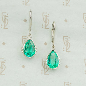pear shaped emerald earrings platinum