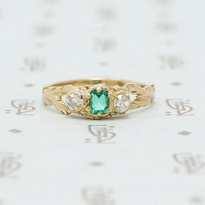 emerald and mine cut diamond ring