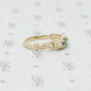 emerald and mine cut diamond ring side view