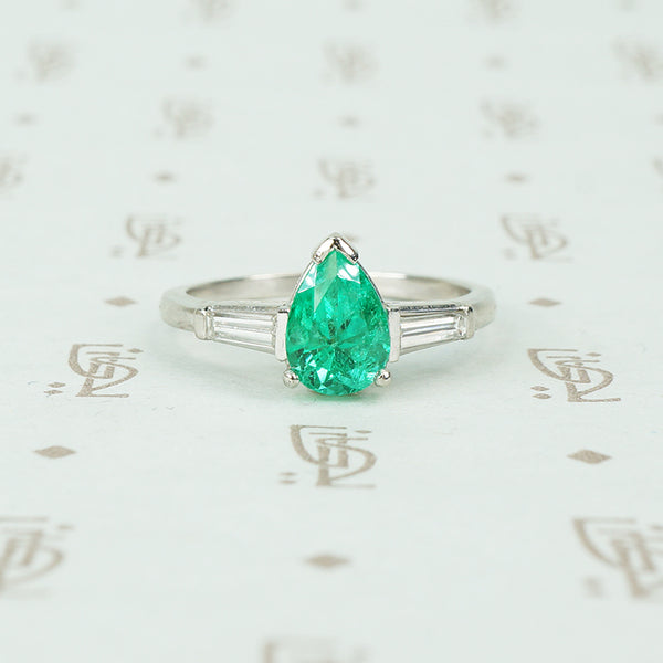 1.08 carat pear shaped emerald platinum baguette diamonds engagement ring
