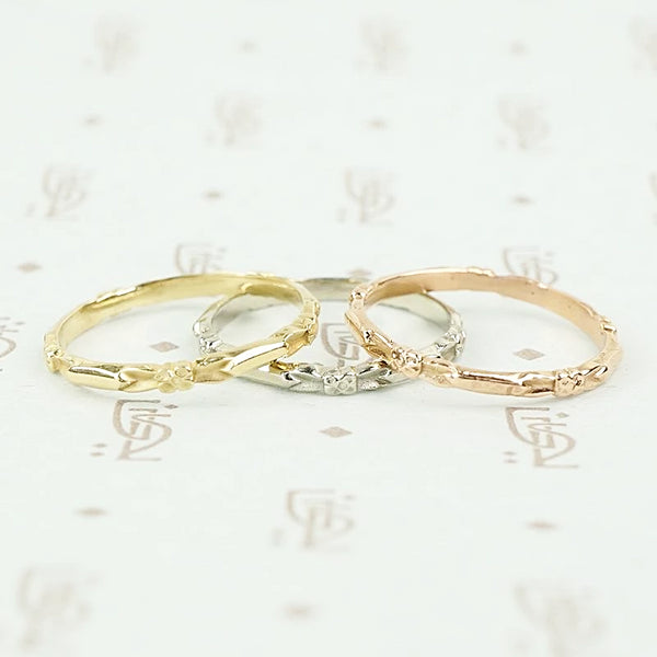Facet Flower Recycled Revival band in rose, yellow and white gold.