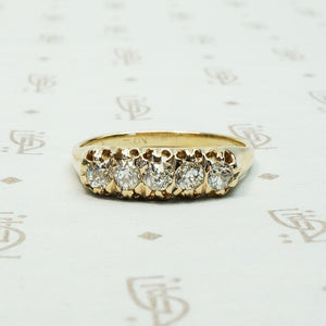 five old mine cut diamond band in melow old yellow gold with flame like ajouring