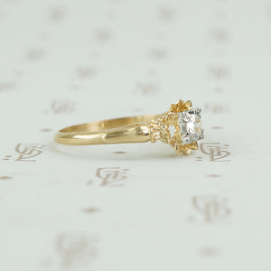 side view showing the details of the yellow gold flower ring