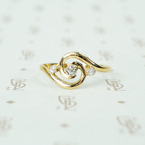 18k yellow gold swirl ring with tiny diamonds set in platinum french hallmarks