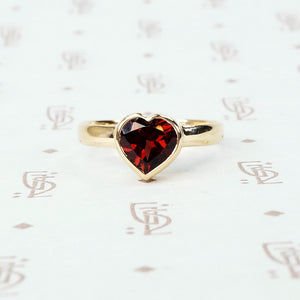 heart shaped garnet ring in 14k yellow gold recycled