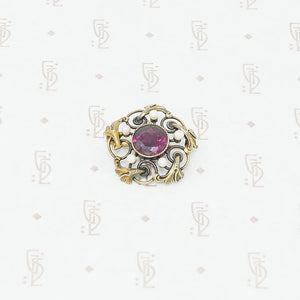 Gold brooch with acanthus leaves a rhodolite garnet and pearls