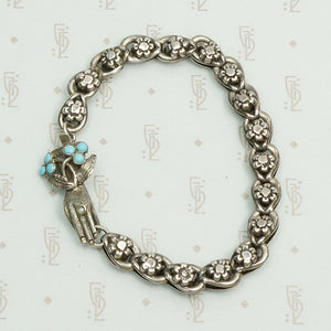 19th century silver flower link bracelet with a bejeweled hand clasp