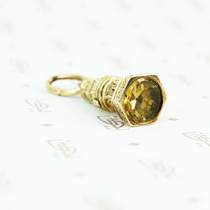 9ct fob with yellow glass stone