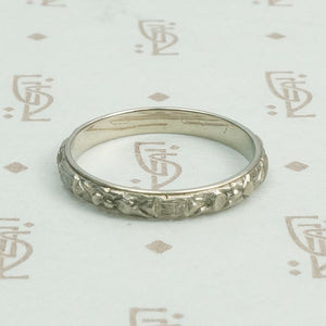 18k White Gold Floral Wedding Band, side view.