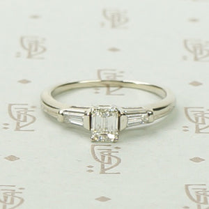 Refined Emerald Step-Cut Diamond Engagement Ring