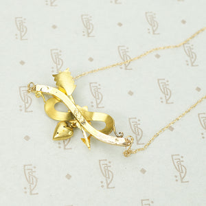 An Arrow a Heart and a Posey Love Token Necklace