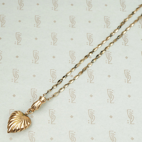 The Heart and Hand Necklace in Rose Gold