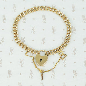 heavy gold filled curb chain bracelet with heart lock and original key