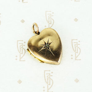 heart shaped antique locket with a star set rose cut diamond